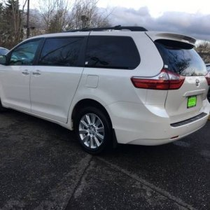 Sienna left rear quarter view - Stock XLE Premium AWD with 18s